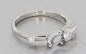 A Contemporary Engagement And Wedding Ring Set Made In Platinum Using Diamonds And Luminescent Cabochon Moonstones