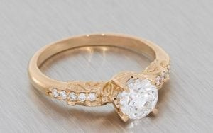 An Enchanting Rose Gold And Diamond Engagement Ring With Intricate Scrollwork To Give The Ring A Fairy Tale Feel