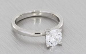 Elegant Platinum Solitaire With Hidden Peak Stone