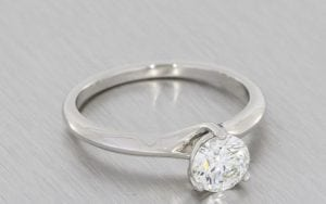 Elegant Three Claw Solitaire With Diamond Set Contoured Band