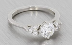 Beautiful Solitaire Engagement ring with Diamond side clusters