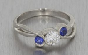 Bespoke diamond and sapphire trilogy engagement ring - Portfolio