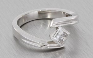 Platinum Princess cut ring set in a groved Bypass shank