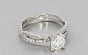 Platinum and diamond crossover engagement ring