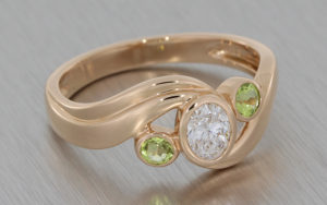 Rose Gold Oval Swirl Ring Set with Diamond and Accented with Peridot