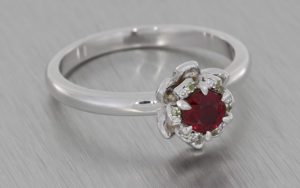 Round Ruby Diamond Ring set with Grain set Petals and Complemented with Accent Peridots
