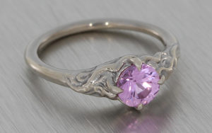 Organic Molten texture ring set with a pale pink sapphire