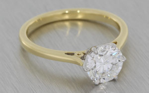 Traditional Solitaire diamond ring set in platinum on a yellow gold band