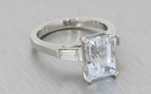 Aquamarine and tapered baguette moissanite trilogy ring set in platinum