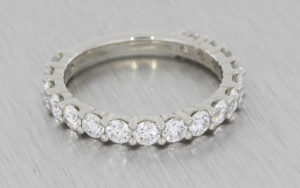 Diamond shared claw eternity band