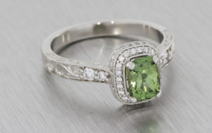 Platinum, green sapphire and diamond ring