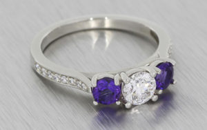 Platinum trilogy ring with amethysts and diamonds