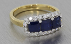 Mixed Metal Sapphire Trilogy Ring with a Cluster of Diamonds