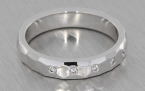 18ct white gold band set with invisible set round brilliant diamonds