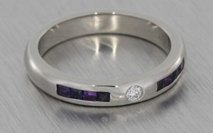 His & hers palladium wedding bands set with diamonds, sapphires and amethysts