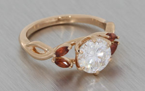 Round Moissanite And Marquise Shape Garnet Ring With An Alluring Twisted Band