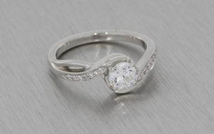 Contemporary and romantic sweeping diamond engagement ring